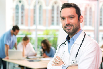 Portrait of a young attractive doctor at the hospital