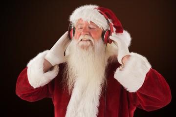 Composite image of santa claus enjoys some music