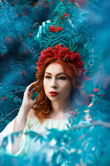 Colorful autumn portrait of beautiful model with rowan berries