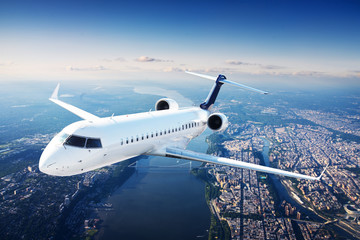 Private jet plane in the blue sky Wall mural