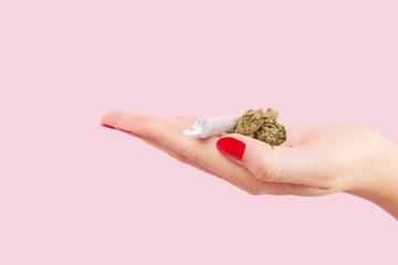 Woman holding cannabis bud.