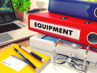 Equipment on Red Office Folder. Toned Image.