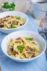 Pasta with mushrooms, cheese and fresh parsley