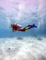 Silhouette of Scuba Diver near Sea Bottom
