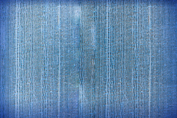 Blue abstract background from silk fabric pattern
