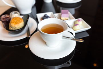 Elegant afternoon tea with bakery snack