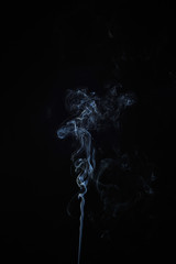 Abstract smoke moves on a black background. Design element. Abstract texture.