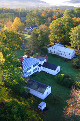 An aerial view of a hot air balloon floating over the Vermont country side ..