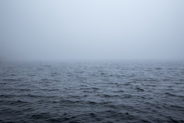 Poster Mer / Ocean Calm surface of a sea during a foggy day
