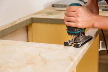 Installing new hob in modern kitchen