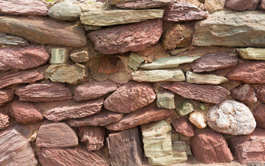 Dry stone wall with red and pink stones Devon England uk