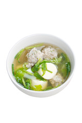 Clear soup with egg tofu, minced pork and vegetable Isolated on
