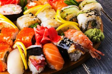Sushi Set: sushi and sushi rolls on wooden plate.