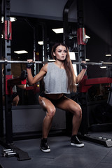 beautiful girl bodybuilder , execute exercise with dumbbells, in