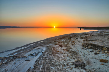 Beautiful sunrise on salt lake Chott el Djerid, Sahara desert, T
