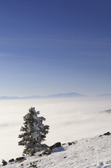 Beautiful mountain landscape with distant peak above clouds.