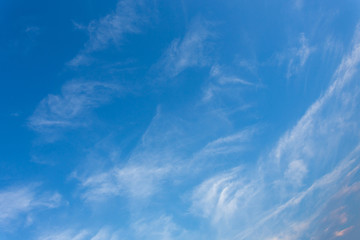 wind blows clouds in blue sky background