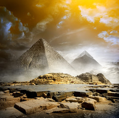 Storm clouds and pyramids