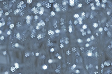 Backgrounds with silver snowflakes lights