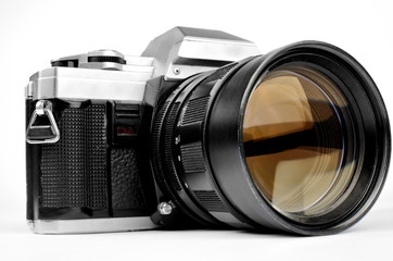 Old-fashion vintage retro camera with big lens isolated on white