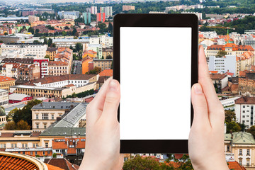 tourist photographs Brno city skyline on tablet