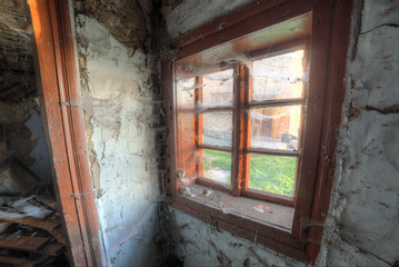Small old window in abandoned house
