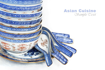 Pile of Bowls and spoons of Asian cuisine, with copy space for text