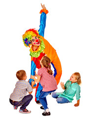 Clown playing on birthday with group children.