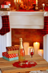 Delicious cupcakes and champagne on home interior background