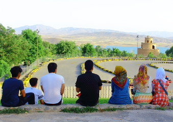 Iranian family watching carting race next to the see!