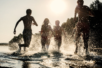 Garden Poster Water Motor sports Backlit shot of teenagers run in water, drop of water shining