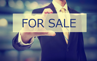 Business man holding For Sale