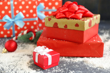 Christmas gifts on color wooden background