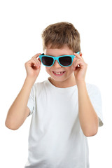 Portrait of happy little boy with sunglasses on white background