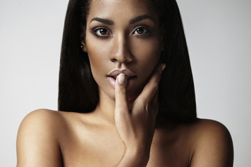 beauty black woman touching her lips