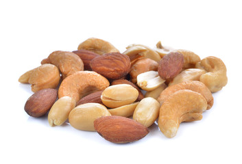 background of mixed nuts - hazelnuts, walnuts, almonds, pine nut