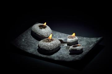 burning candles isolated on black