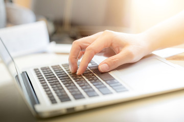 Woman's hands typing on laptop keyboard : Selective Focus