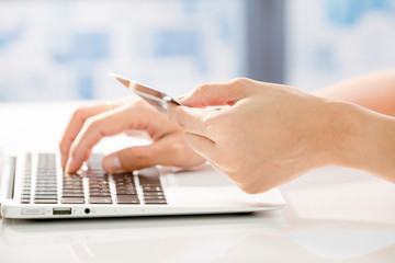 Woman Hands holding credit card and using laptop. Online shoppin
