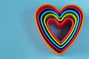 colorful plastic hearts on a blue background