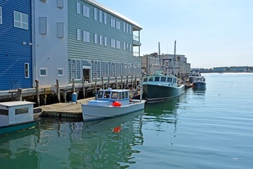 a row of fishing vessels anchored at the Holyoke Wharf, Portland Maine