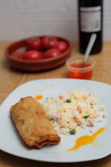 fried rice and spring roll with sweet and sour sauce