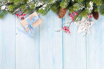 Christmas background with fir tree and gift