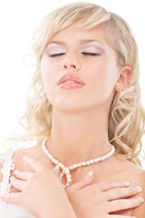 Young bride has closed eyes