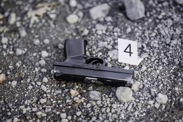 Crime scene investigation -black pistol evidence