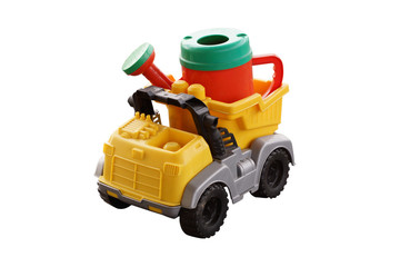 Plastic watering can in the back of a toy car.