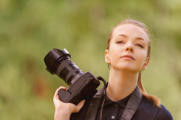 young woman photographs on camera