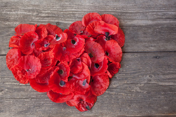 Heart of red poppy petals