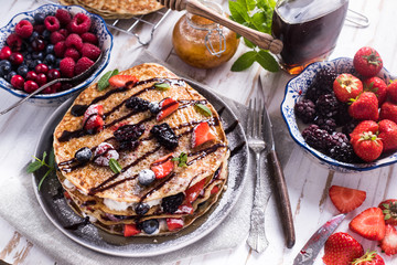 Fresh crepes with fruits and chocolate