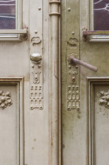 old steel door with decorative pattern in neogothic stone portal